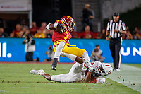 LOS ANGELES, CA - SEPTEMBER 7: Stanford Cardinal cornerback Paulson Adebo #11 tackles USC Trojans running back Stephen Carr #7 during a game between USC and Stanford Football at Los Angeles Memorial Coliseum on September 7, 2019 in Los Angeles, California.