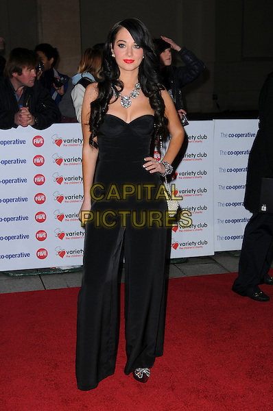 TULISA CONTOSTAVLOS of N-DUBZ.The Co-operative Variety Club Showbiz Awards, Grosvenor House Hotel, Park Lane, London, England, UK, .14th November 2010. .full length black bustier catsuit hand on hip pantsuit jumpsuit .CAP/CAS.©Bob Cass/Capital Pictures.