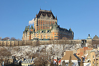 Chateau Frontenac, opened 1893, designed by Bruce Price as a chateau style hotel for the Canadian Pacific Railway company or CPR, with rooftops of Petit Champlain below, in Quebec City, Quebec, Canada. The building was extended and the central tower added in 1924, by William Sutherland Maxwell. The building is now a hotel, the Fairmont Le Chateau Frontenac, and is listed as a National Historic Site of Canada. The Historic District of Old Quebec is listed as a UNESCO World Heritage Site. Picture by Manuel Cohen