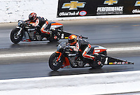 May 16, 2015; Commerce, GA, USA; NHRA pro stock motorcycle rider Andrew Hines (near) races alongside teammate Eddie Krawiec during qualifying for the Southern Nationals at Atlanta Dragway. Mandatory Credit: Mark J. Rebilas-USA TODAY Sports