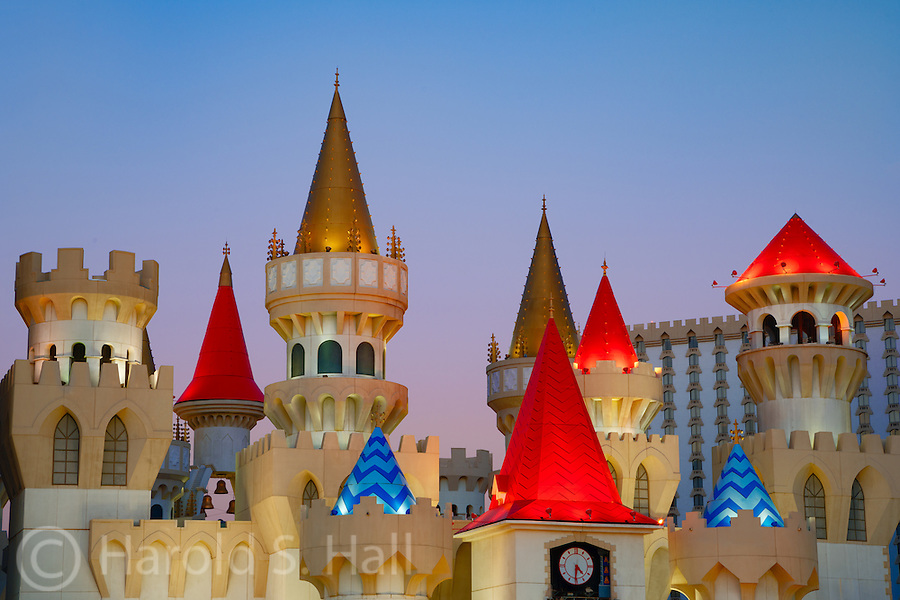 Colorful spires of the Excalibur gambling casinos in Las Vegas at dusk.  It looks like it could at home in Russia or maybe Disneyland.