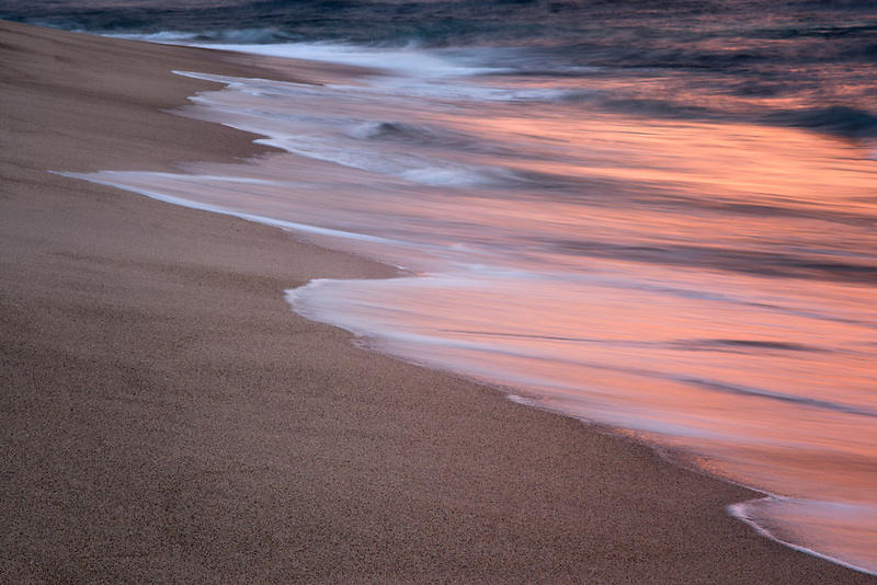 Ocean wave reflecting sunset. Punta Mita, Mexico