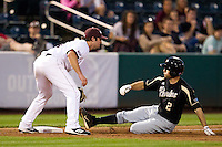 Eric Charles (2) of the Purdue Boilermakers slides into third base during a game against the Missouri State Bears at Hammons Field on March 13, 2012 in Springfield, Missouri. (David Welker / Four Seam Images)