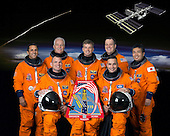 Houston, TX - (FILE) (16 May 2008) --- File photo from May 16, 2008.  Attired in training versions of their shuttle launch and entry suits, these seven astronauts take a break from training to pose for the STS-119 crew portrait. From the right (front row) are NASA astronauts Lee Archambault, commander, and Tony Antonelli, pilot. From the left (back row) are NASA astronauts Joseph Acaba, John Phillips, Steve Swanson, Richard Arnold and Japan Aerospace Exploration Agency astronaut Koichi Wakata, all mission specialists. Wakata is scheduled to join Expedition 18 as flight engineer after launching to the International Space Station on STS-119..Credit: NASA via CNP