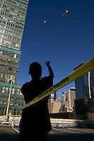13 years-old Brandon Carter flies a kite from the rooftop of the Port Authority bus terminal in New York City, USA, during the third annual Kite Flight event, 23 September 2007.