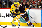 09 APR 2011: Trent Palm (5) of University of Minnesota, Duluth and Derek DeBlois (18) of the University of Michigan battle for the Puck during the Division I Men's Ice Hockey Championship held at the Xcel Energy Center in St. Paul, MN.  Minnesota-Duluth beat Michigan in overtime, 3-2 to claim the national title. Vince Muzik/NCAA Photos