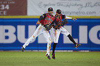 (L-R) Bubba Thompson (25) and Miguel Aparicio (36) celebrate following their win over the Kannapolis Intimidators at L.P. Frans Stadium on July 20, 2018 in Hickory, North Carolina. The Crawdads defeated the Intimidators 4-1. (Brian Westerholt/Four Seam Images)