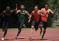 Apr 11, 2015; Los Angeles, CA, USA; Hugh Pegan takes the handoff from Jeh Johnson on the second leg of the Occidental College 4 x 100m relay in a SCIAC multi dual meet at Occidental College. Photo by Kirby Lee