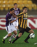Phoenix' Diego Walsh holds off Perth captain Jacob Burns during the A-League football match between Wellington Phoenix and Perth Glory at Westpac Stadium, Wellington, New Zealand on Sunday, 16 August 2009. Photo: Dave Lintott / lintottphoto.co.nz