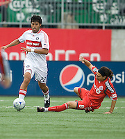 16 May 09: Chicago Fire defender Wilman Conde #22 and Toronto FC forward Pablo Vitti #8 in action at BMO Field in a game between the Chicago Fire and Toronto FC..Chicago Fire won 2-0..