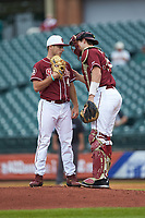 Florida State Seminoles catcher Cal Raleigh (35) talks with starting pitcher Drew Parrish (43) at the mound against the Notre Dame Fighting Irish in Game Four of the 2017 ACC Baseball Championship at Louisville Slugger Field on May 24, 2017 in Louisville, Kentucky. The Seminoles walked-off the Fighting Irish 5-3 in 12 innings. (Brian Westerholt/Four Seam Images)