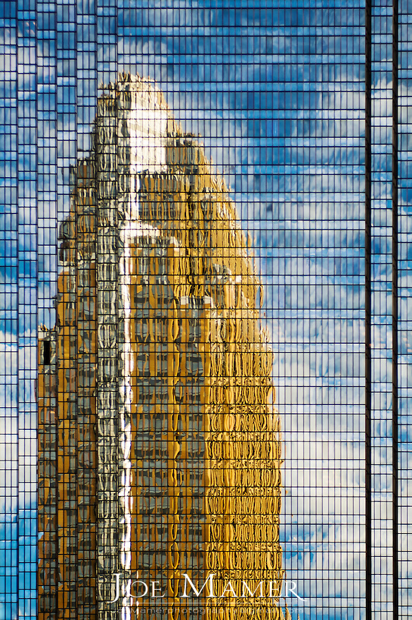Wells Fargo Center (formerly Norwest), designed by Cesar Pelli reflected in the windows of the IDS Center, designed by Phillip Johnson with Edward Baker Associates..