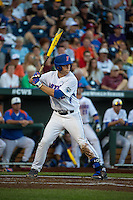 JJ Schwarz (22) of the Florida Gators bats during a game between the Miami Hurricanes and Florida Gators at TD Ameritrade Park on June 13, 2015 in Omaha, Nebraska. (Brace Hemmelgarn/Four Seam Images)