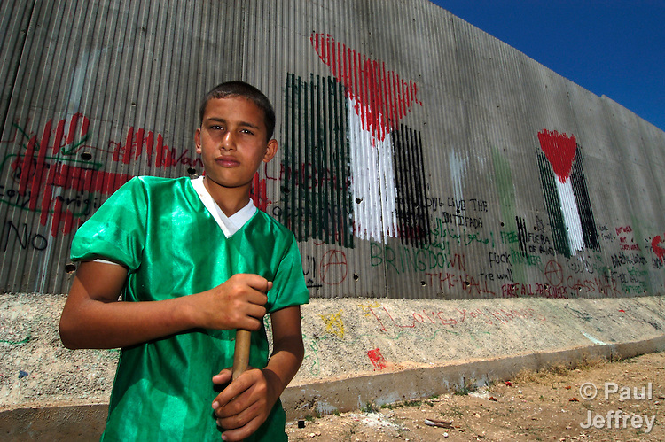 An 8-meter high Israeli-built concrete wall surrounds the West Bank town of Qalqilya. Here the wall has been painted by protesters.