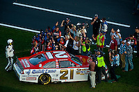 Trevor Bayne (#21) celebrates victory with his crew in the tri-oval.