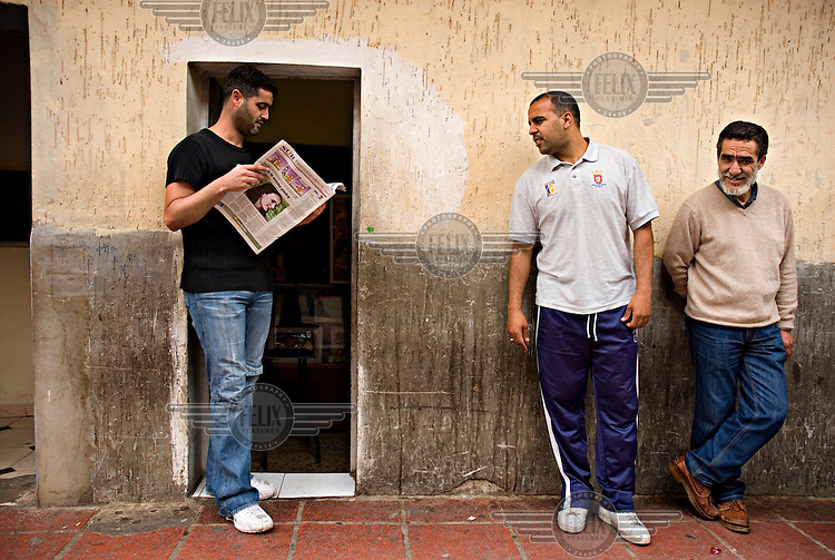 A man reading a newspaper outside a house in the El Principe neighbourhood inside the Spanish enclave of Ceuta. Due to its strategic location on the North African coast, Ceuta is significant to Spanish immigration.