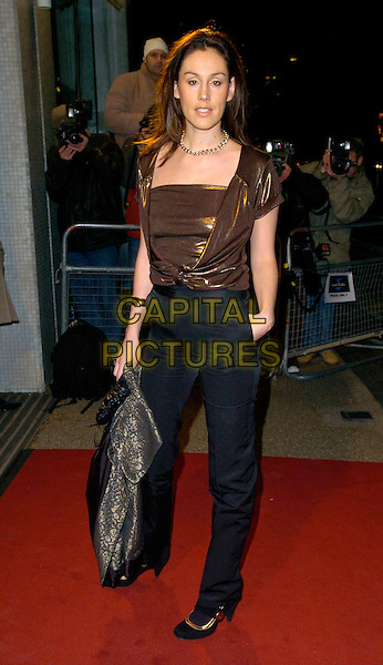"LUCY RUSEDSKI .Arrivals - ""An Audience With Lionel Richie"" TV recording, ITV Television Centre, Aouth Bank, London, England, December 9th 2006..full length married husband wife gold metallic top bronze black trousers.CAP/CAN.©Can Nguyen/Capital Pictures"