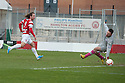 Accies Stevie May sees his shot saved by Raith goalkeeper David McGurn.