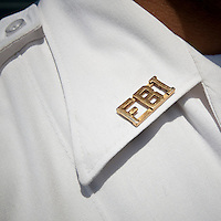 View of an FBI Police officer's FBI pin on his white shirt at the FBI Academy in Quantico, VA, USA, 12 May 2009.