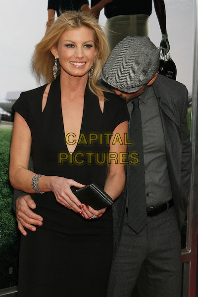 "FAITH HILL & TIM McGRAW.The New York City Premiere of ""The Blind Side"" held at the Ziegfeld Theater, New York, NY, USA..November 17th, 2009.half length black cut out low plunging neckline shoulders dress slashed grey jacket gray hat cap suit tie clutch bag married couple husband wife kiss kissing shoulder funny .CAP/LNC/TOM.©TOM/LNC/Capital Pictures."