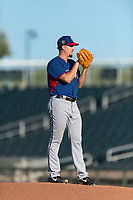 AZL Rangers starting pitcher Chi Chi Gonzalez (21) looks in for the sign during a rehab start in an Arizona League playoff game against the AZL Indians 1 at Goodyear Ballpark on August 28, 2018 in Goodyear, Arizona. The AZL Rangers defeated the AZL Indians 1 7-4. (Zachary Lucy/Four Seam Images)