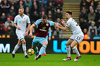 Burnley's Sam Vokes vies for possession with Swansea City's Federico Fernandez<br /> <br /> Photographer Ashley Crowden/CameraSport<br /> <br /> The Premier League - Swansea City v Burnley - Saturday 10th February 2018 - Liberty Stadium - Swansea<br /> <br /> World Copyright &copy; 2018 CameraSport. All rights reserved. 43 Linden Ave. Countesthorpe. Leicester. England. LE8 5PG - Tel: +44 (0) 116 277 4147 - admin@camerasport.com - www.camerasport.com