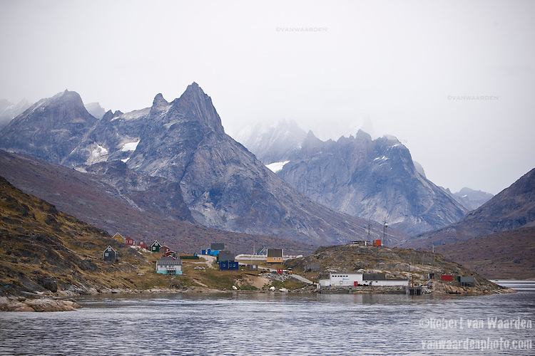 The small village of Tasiussaq in Tasermiut Fjord, Greenland backdropped by mountains.