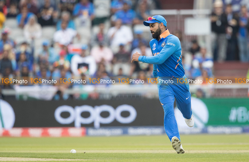 Virat Kolli (India) races in to field during India vs New Zealand, ICC World Cup Semi-Final Cricket at Old Trafford on 9th July 2019