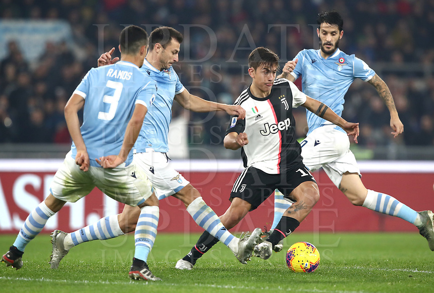 Football, Serie A: S.S. Lazio - Juventus Olympic stadium, Rome, December 7, 2019. <br /> Juventus' Paulo Dybala (second from right) in action with Lazio's Stefan Radu (second from left), Luis Felipe (l),   Luis Alberto (r) during the Italian Serie A football match between S.S. Lazio and Juventus at Rome's Olympic stadium, Rome on December 7, 2019.<br /> UPDATE IMAGES PRESS/Isabella Bonotto