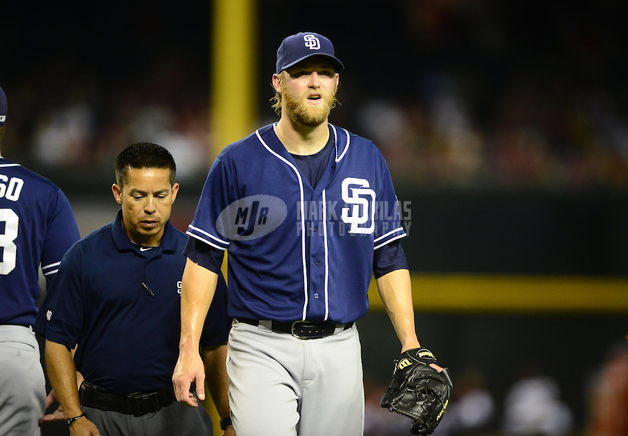 Jul. 3, 2012; Phoenix, AZ, USA: San Diego Padres pitcher Andrew Cashner (right) leaves the field with a trainer after suffering an injury in the third inning against the Arizona Diamondbacks at Chase Field. Mandatory Credit: Mark J. Rebilas-