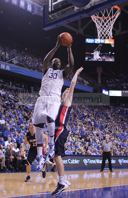 Forward Julius Randle went for the basket during the first half of the University of Kentucky men's basketball game vs. Belmont University at Rupp Arena in Lexington, Ky., on Saturday, December 21, 2013. Kentucky leads Belmont - at the half. Photo by Marcus Dorsey | Staff.
