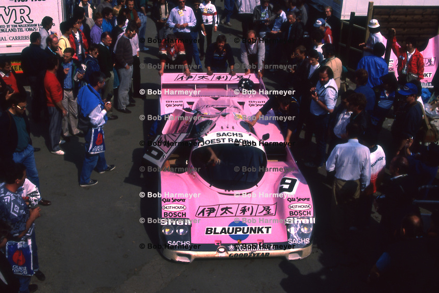 LE MANS, FRANCE - JUNE 11: The Joest Racing Porsche 962C 145 of Bob Wollek and Hans Stuck is pushed through the paddock area before the 24 Hours of Le Mans at the Circuit de la Sarthe in Le Mans, France, on June 11, 1989.