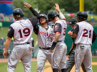 NWA Democrat-Gazette/JASON IVESTER<br /> Arkansas Travelers Dario Pizzano (from left), Tyler Marlette, Ian Miller and Joey Wong celebrate following Marlette's grand slam in the fourth inning Tuesday, June 13, 2017, against the Northwest Arkansas Naturals at Arvest Ballpark in Springdale.