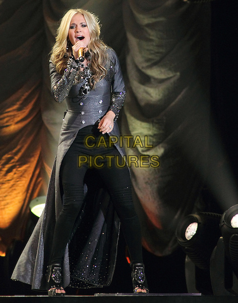 CARRIE UNDERWOOD.Carrie Underwood performs on her Play On Tour, 1st Mariner Arena, Baltimore, Maryland, USA..November 16th, 2010.**Editorial Only!**.stage concert live gig performance music gig full length black jeans denim open toe boots grey gray long coat beads beaded singing .CAP/EAST/EML.©EML/Eastman/Capital Pictures.