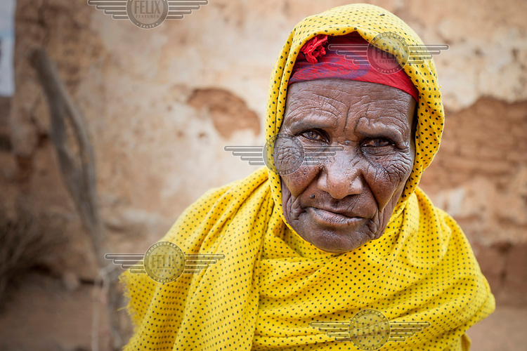 An elderly woman in a yellow headscarf. <br /> The Horn of Africa is experiencing a devastating drought with over 11m people threatened by famine.