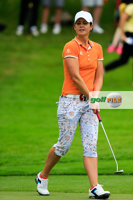 Maria Dunne on the 17th green during the Saturday morning foursomes at the 2016 Curtis cup from Dun Laoghaire Golf Club, Ballyman Rd, Enniskerry, Co. Wicklow, Ireland. 11/06/2016.<br /> Picture Fran Caffrey / Golffile.ie<br /> <br /> All photo usage must carry mandatory copyright credit (&copy; Golffile | Fran Caffrey)