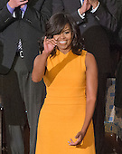 First lady Michelle Obama waves as she arrives prior to United States President Barack Obama delivering his final State of the Union Address in the US House Chamber in the US Capitol on Tuesday, January 12, 2016.<br /> Credit: Ron Sachs / CNP<br /> (RESTRICTION: NO New York or New Jersey Newspapers or newspapers within a 75 mile radius of New York City)