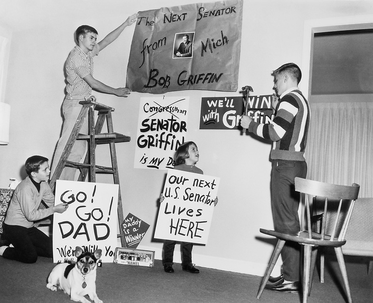 Children of Sen. Robert P. Griffin, R-Mich. tacking up signs in their dinning room at home in 1966. (Photo by CQ Roll Call)