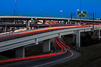 "Traffic light trails line the ""Spaghetti Highway"" Mopac exchange in northwest Austin, connects Highway 183, Mopac Loop 1 and Loop 360, the Capital of Texas Highway."