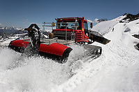 "Machinery clears the way for workers on Brunnenkogel Ferner.  It is being wrapped with a fleece-like cover to keep it from melting.  Covered ice melts slower. <br /> The ski area at 3,400 meters is covered to help save the ski industry since the glacier is retreating.  The cost of materials is one Euro per square meter.<br /> <br /> The Alpine glaciers -- in Austria, Switzerland, France and Italy -- are losing one percent of their mass every year and, even supposing no acceleration in that rate, will have all but disappeared by the end of the century. More hot, dry summers like that of 2003 in Europe, when the loss speeded to five percent, could cut the life expectancy to no more than 50 years, according to Wilfried Haeberli of the University of Zurich...""We estimate that by the end of the 21st century, with a medium-type climate scenario, about five percent of what existed in the 1970s will have survived, he added."