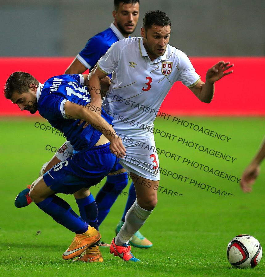 Fudbal<br /> Prijateljski mec-Friendly match<br /> Srbija v Grcka<br /> Dusko Tosic (R) and Charis Mavrias<br /> Chania, 18.11.2014.<br /> foto: Srdjan Stevanovic/Starsportphoto &copy;