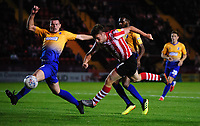 Lincoln City's Shay McCartan gets in a shot under pressure from Mansfield Town's Matt Preston<br /> <br /> Photographer Chris Vaughan/CameraSport<br /> <br /> The EFL Checkatrade Trophy Group H - Lincoln City v Mansfield Town - Tuesday September 4th 2018 - Sincil Bank - Lincoln<br />  <br /> World Copyright © 2018 CameraSport. All rights reserved. 43 Linden Ave. Countesthorpe. Leicester. England. LE8 5PG - Tel: +44 (0) 116 277 4147 - admin@camerasport.com - www.camerasport.com