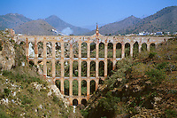 Aqueduct bringing water to agricultural fields. Masonry arches. Structural arch. Neja Andalucia Spain.
