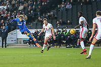 Lyle Taylor of AFC Wimbledon shoots during the Sky Bet League 1 match between MK Dons and AFC Wimbledon at stadium:mk, Milton Keynes, England on 13 January 2018. Photo by David Horn.