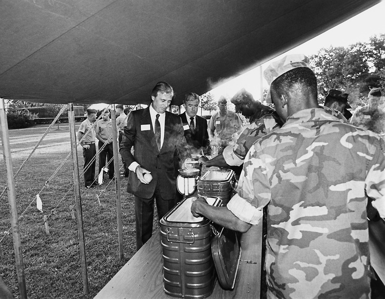 Rep. Eldon Rudd, R-Ariz., being served by soldiers at military camp. (Photo by CQ Roll Call)