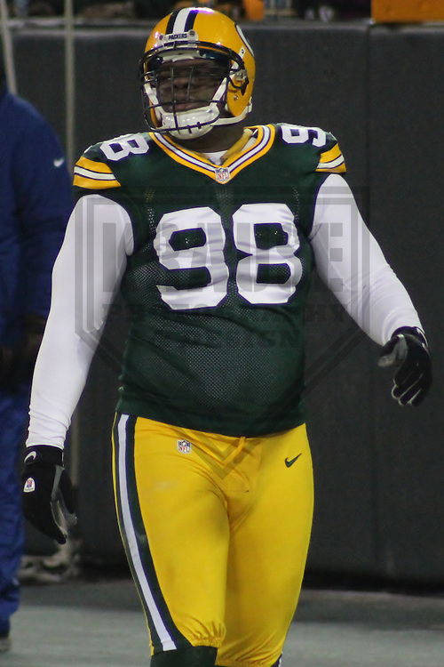 GREEN BAY - January 2013: C.J. Wilson (98)  of the Green Bay Packers prior to a NFC Playoff game against the Minnesota Vikings  on January 5, 2013 at Lambeau Field in Green Bay, Wisconsin. Green Bay defeated Minnesota 24-10. (Photo by Brad Krause).