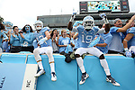 12 September 2015: UNC's Andrew Moore (12) and Kedrick Davis (19) jump into the stands before the game. The University of North Carolina Tar Heels hosted the North Carolina A&T State University Aggies at Kenan Memorial Stadium in Chapel Hill, North Carolina in a 2015 NCAA Division I College Football game.