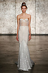 Model walks runway in a jewel VIP strapless sequined mermaid from Inbal Dror Fall 2018 bridal collection on October 5, 2017; during New York Bridal Fashion Week.