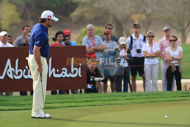 Graeme McDowell on the 13th green on day 3 of the Abu Dhabi HSBC Golf Championship 2011, at the Abu Dhabi golf club, UAE. 22/1/11..Picture Fran Caffrey/www.golffile.ie.