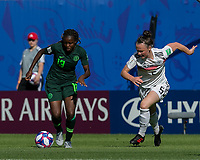 GRENOBLE, FRANCE - JUNE 22: Ngozi Okobi #13 of the Nigerian National Team dribbles as Marina Hegering #5 of the German National Team closes during a game between Nigeria and Germany at Stade des Alpes on June 22, 2019 in Grenoble, France.